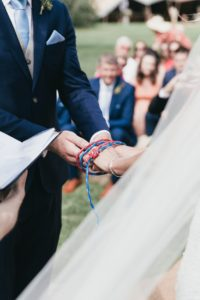 climbing rope wrapped around their hands for handfasting