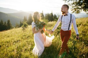 couple hold hands after their hilltop wedding ceremony outdoor humanist wedding ceremony
